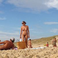 Playing at The Nude Beach - Beach Voyeur , I Couldn't Resist To Take Pictures And To Film This Couple At The Nude Beach In France. Here Is A Fine Selection Of A Set Of More Than 50 Images.