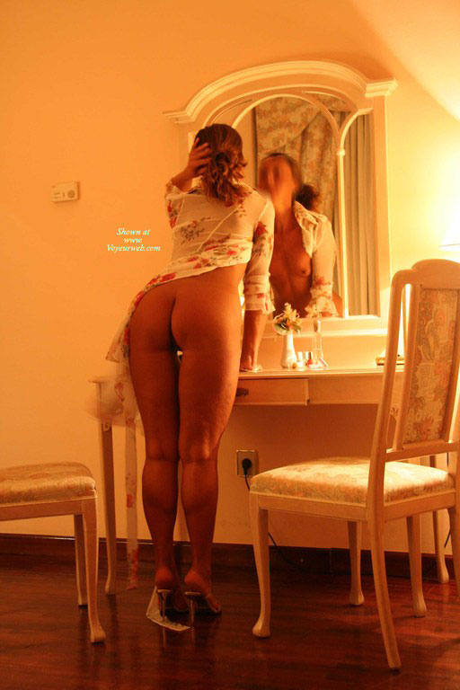 Looking Into Mirror - Round Ass , Bottomlesss, Standing On Tiptoes, Ass Toward Camera, Girl In Mirror, Shapely Legs, Bending Slightly Forward, Rearview, Small Breast