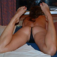 Butt Floss - Brunette Hair, Long Hair, Sexy Feet , Curley Brunette, Bottom Pressure, Rear View, Lying Down On Stomach, Buns Up, Spread In Thong, Red Toes