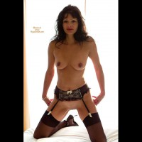 Kneeling Up On Bed - Dark Hair, Milf, Pierced Nipples, Shaved Pussy, Spread Legs , Milf With Stocking, Legs Spread Wide Apart, Hands Touching Her Bottom, Dark Eyes, Pierced Nipple, Dark Nipples, Full Lips, Direct Gaze To Camera, Frontal Pose