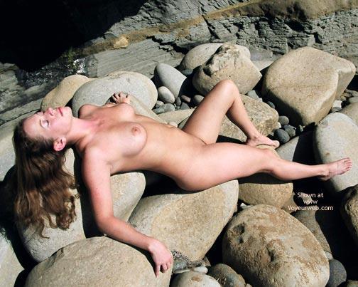 Naked On Rocks - Eyes Closed, Long Hair , Naked On Rocks, Long Brown Hair, Eyes Closed, Lying On Her Back, Big Boobs On Rocks, Enjoying The Sun