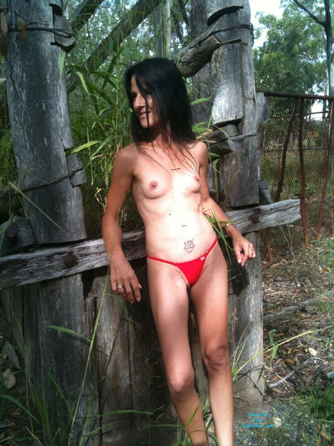 Red Bikini - Bikini, Brunette Hair, Small Tits , Her Second Attempt At Nude In A Public Place Was On Some Random Property We Passed, This Was Someones Old Cattle Yard.