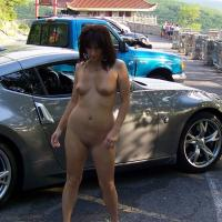 """Posing With The Car Guys - Brunette Hair, Exposed In Public, Nude In Public , We Were Out Taking Pics Around The Local Landmarks Earlier This Summer When We Came Across These Guys Hanging Out On The Side Of The Road With Their Cars.  We Rolled Up And Asked If We Could Take Some Pics Of Monique With Their Rides.  Monique Called Out, """"I'm Naked!"""" And Shook Her Tits At Them.  So We Swung Around, Parked, And Monique Jumped Right Out And Started Posing With The Blue Car.  The Dude With The Socks And Sandals Was Taken By Surprise And Almost Flipped Out That Someone Would Actually Touch His Car...until He Realized It Was A Naked Chick.  Then All Was Right In His World."""