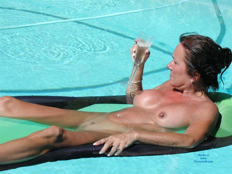 Topless mature at pool #10