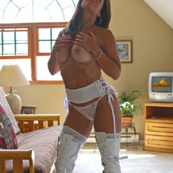 White Fuck Me Boots - Big Tits, Brunette Hair, Heels, Sexy Lingerie , A Lazy Afternoon With Some Great Sunlight Streaming Through The Window And A New Pair Of White Thigh High Fuck Me Boots. What Else Does A Girl Need To Lounge Around And Play With Her Tits? How About The Photographer Helping Me Out When I'm Done Teasing Them? Hope You Like What You See. If You Do Let Me Know And Maybe We Can Put Up Some Other Contris.