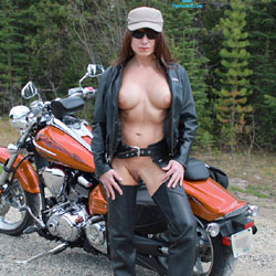 Biker Babe - Big Tits, Nude In Public, Shaved , Went Out For A Ride And Came Upon This Awesome Spot For A Few Pics.So Naturally As Is My Way I Stripped Down And Struck A Few Poses For The Camera. The Couple Of The Cars That Drove By Enjoyed The Shoot As Well. They Seemed Quite Surprised When They Drove Over The Bridge And Saw Me Naked As The Day I Was Born Posing By The Water. Bad Biker Girl!!! (hehehe) Oh Well.