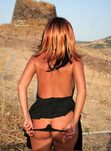 Girl Raises Skirt And Thong Pulled Down , From Behind, Taking Pants Off During Walk Outside, Black String Under Dress, Panties Down, Black Dress, Raising Skirt And Pulling Down Thong, Pinched Thong, Black String, Black Dress With White Polka Dot Pattern
