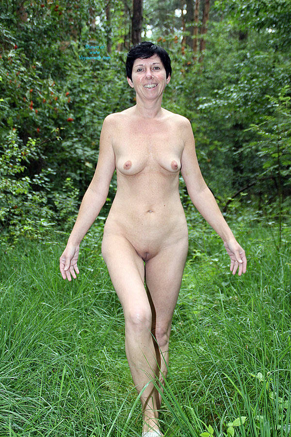 girls having a nude walk in the forest