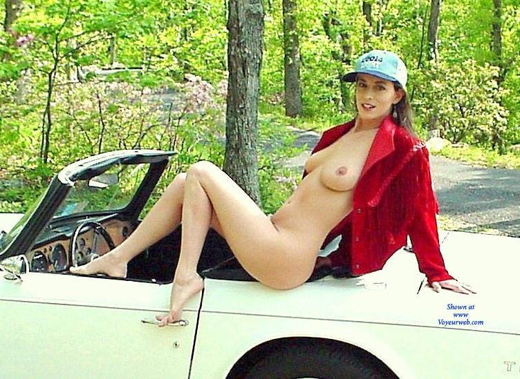 Hot girl with big tits and ass on car