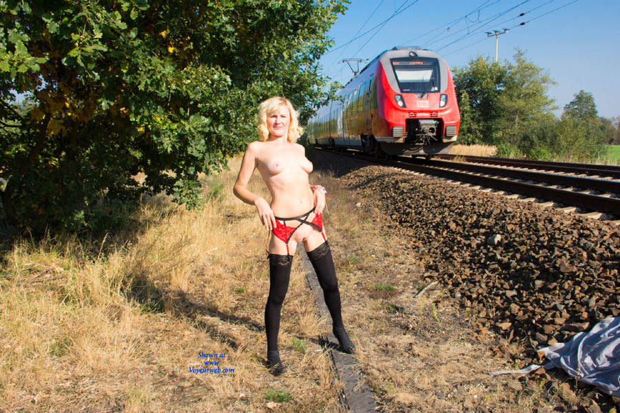 Naked girls on railroad tracks