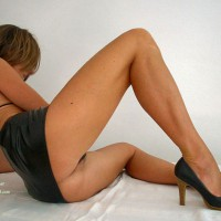 Sexy Girl In Black Micro Mini And High Heels - Heels, Spread Legs , Looking Away, Reclining On A Floor, Black Mini Skirt, Black Leather Miniskirt, Black Halter Top, Black Open Toe Pumps With Wooden Heels, Legs Spread On A Floor, Black Micro Mini, Spread Legs