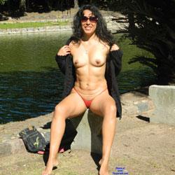 Nude Brunette In A Public City Park