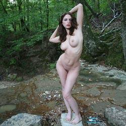 Naked Brunette In Nature