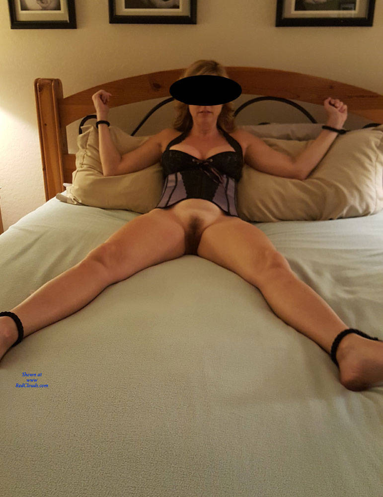 Girl blindfolded and tied to bed