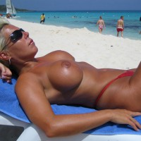 Blonde On Beach Topless In Red Bikini Bottoms - Blonde Hair, Sunglasses, Topless, Beach Voyeur , Dark Sunglasses, Red Thong, Blonde Sunbathing, Red Bikini Bottom, Platinum Blonde Hair, Large Round Tits, Lying On Back At Beach, Topless Sunbathing