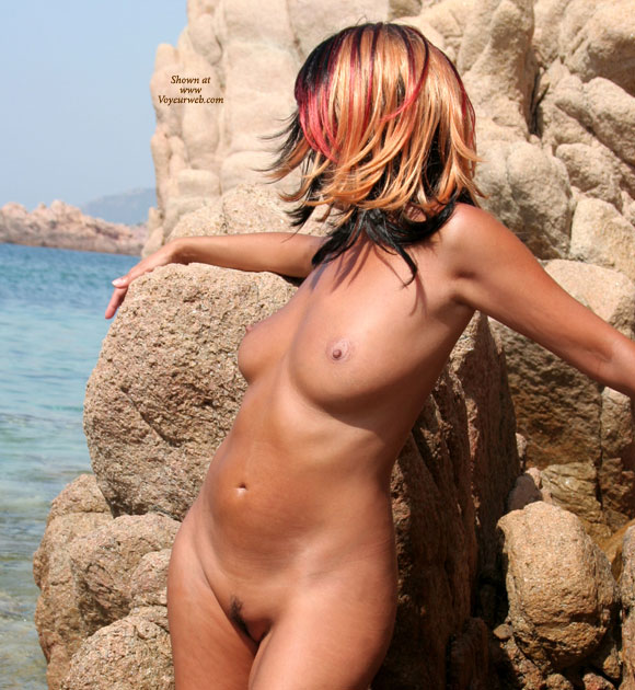 Half Profile Of Standing Nude Girl - Landing Strip, Natural Tits, Naked Girl, Nude Amateur , Tanned Skin, Light Brown Ariola, Arms Are Outstretched, Posing At The Beach, Head Is Turned Fully Away, Multi Colored Hair, Streaky Hair, All Over Tan