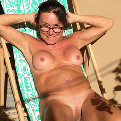 Sunning In The Backyard - Nude Amateurs, Big Tits, Brunette, Mature, Outdoors, Shaved
