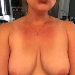 Medium tits of a neighbor - Julie