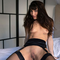 Stockings, Garterbelt And A Bed
