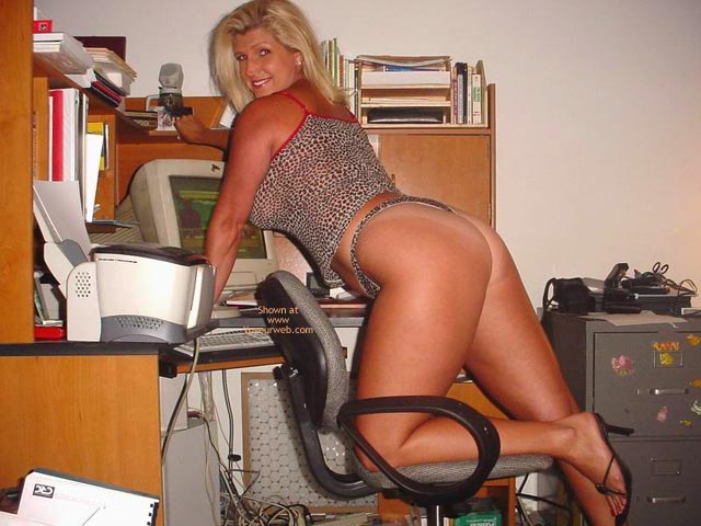 Pic #1 Hot Legs In Her Office