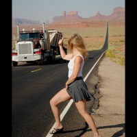 Hitch Hicking On The Road , Public Flash, Black Strapped Shoes, Charcoal Short Skirt