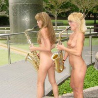 Two Nude Girls Playing Instrument - Girls, Nude In Public , Two Nude Girls Playing Instrument, Nude In Public, Group Shot, Two Girls, Exhibitionist Girl, Saxophone