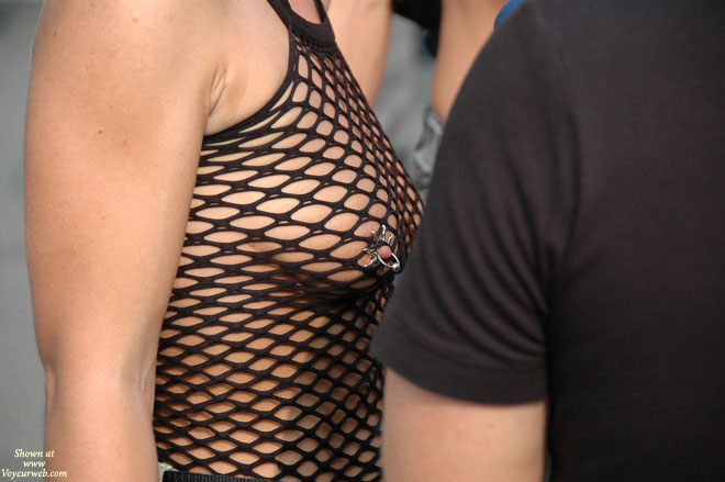 Nipple Piercing - Exhibitionist , Fishnet Top, Exposed In Public, Nipple Jewelry, Nipple Jewellery, Black String Bodystocking, Pierced Nipple, Street Voyeur, Black Net Shirt, Nipple Piercing In Public, Piercing With A Nipple Shield, Breast Piercing