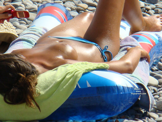Gorgeous Girl Sunbathing On A Pebbly Beach - Big Tits, Topless Beach, Topless, Beach Tits, Beach Voyeur , Topless Voyeur Beach Shot, Topless Sunbathing, Blue Bikini, Topless Girl On Beach, Tiny Blue Bathing Suit Bottom, Oiled Body, Blue Bikini Bottom, Big Tan Tits, Really Tan Tits, Tan Tits, Sun Bathing