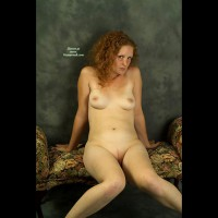 Shy Redhead On A Settee - Milf, Red Hair, Shaved Pussy, Small Tits , Red Head, Pale Naked, Leaning Back On Hands, Knees Joined Legs Apart, Full Frontal, Sitting Knees Together, White Milf
