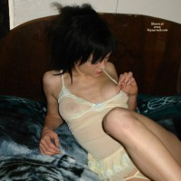 Wife Pinching Her Own Nipple - Black Hair , Pulling Nipple, Yellow Nightie, Enjoying Herself, Lying On A Bed, One Knee Drawn Up To Her Chest, Top Partially Down