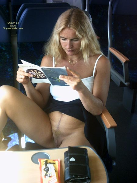 Pantyless In Train - Blonde Hair, Pussy Flash , Pantyless In Train, Flashing Pussy, Blonde Hair, Reading Book, Blond Milf, Airing The Goods, Public Display, Flashing Blond