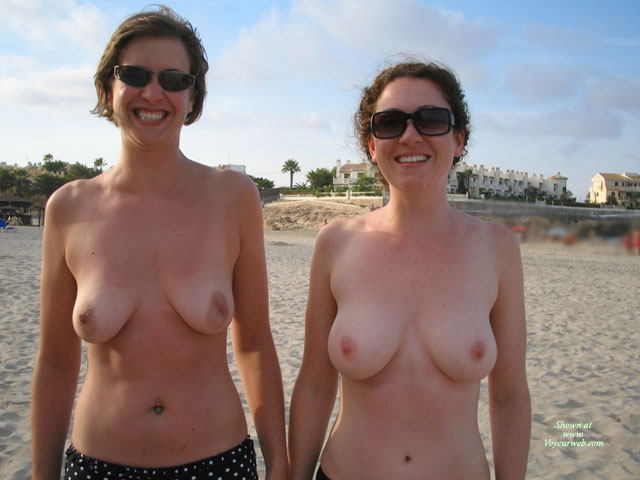 topless Mature beach woman