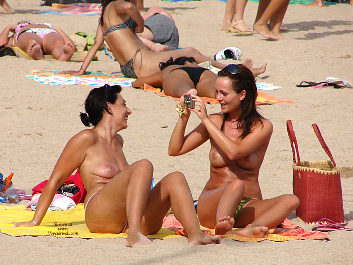 Topless Women Sitting At Beach - Topless, Beach Voyeur, Naked Girl, Nude Amateur , Two Topless Taking Pictures, Taking Pictures At Nudes On Beach, Beach Pictures Two Girls, Beach Shot, Two Topless Girls Having Fun In The Sun, Nude At Beach, Topless Beach, Beach Nude, Topless Beach Photo Op, Two Topless Women Sitting Outdoors