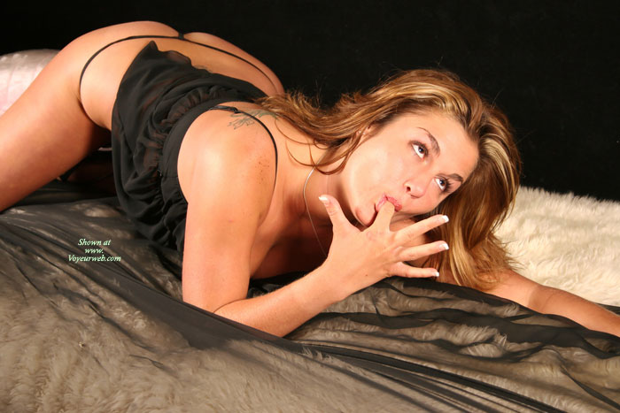 Sexy Finger Sucking Pose , Classic Bed Shot, Kneeling On Bed Sucking Finger, Eyes Looking Away, Sucking Finger, Black Thong, Kneeling On Bed, Licking Finger, Tatoo On Shoulder, Sucking On Finger, Black Teddy