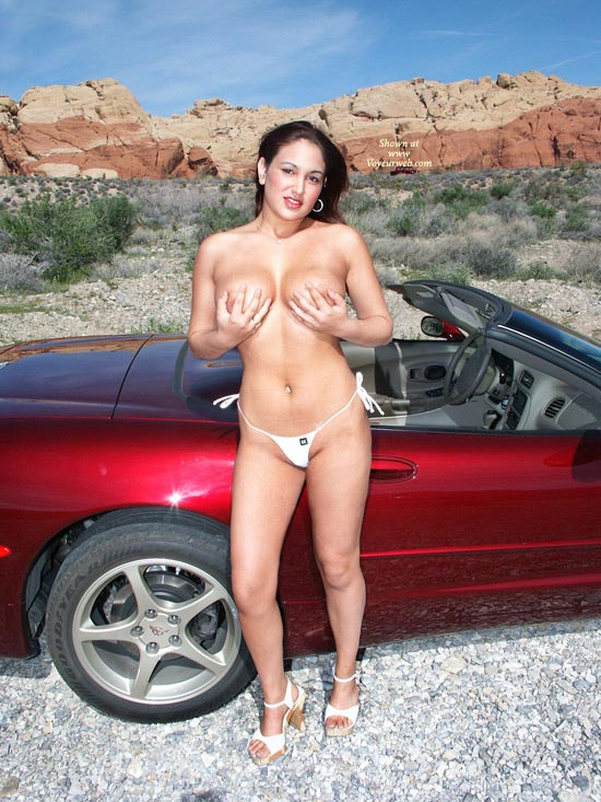 Topless Roadside Next To Car - Heels, Topless , White High Heels Sandals, Standing In Front Of A Car, Girl & Car, White Bikini Bottom, Hands Full Before Car, Cupping Breasts, Topless Standing By Car In The Desert, Corvette, Corvette And Model, Hoop Earrings, Hand Bra, Topless By Car, Desert Girl Covering Boobs