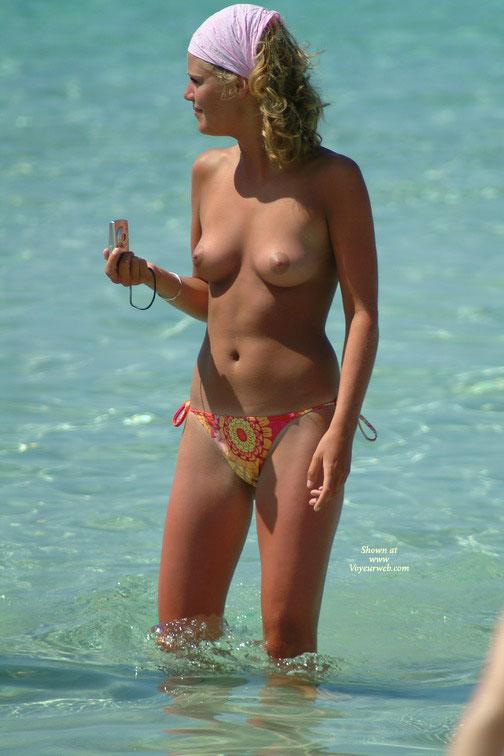 Beach Voyeur - Blonde Hair, Topless Beach, Topless, Beach Voyeur , Pink Head Kerchief, Brown Aerola, Perfect Jugs, Pink Areolas, Red Patterned Bikini Bottom, Medium Natural Breasts