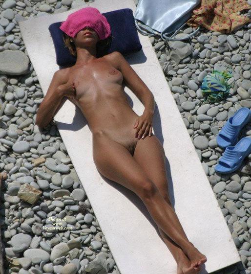 nudist-beach-voyeur-shoots-naked-babes-sunbathing-sucking-cock