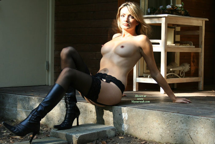 Artistic Outdoors - Perky Nipples, Stockings, Small Areolas , Naked Outside, Black Suspenders, Black High Heel Boots, Contrasts In Colors, Pointed Nipples, Naked In Heels, Sexy Mature, Reclining On The Edge Of The Step