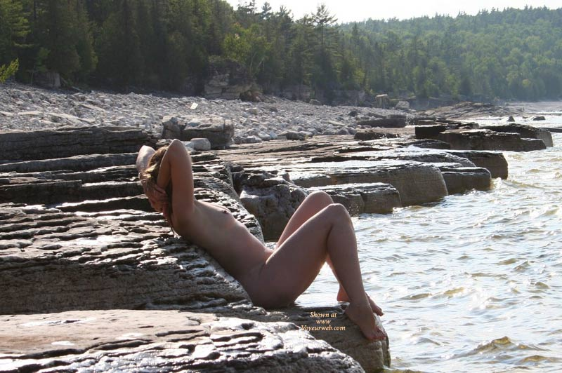 Naked On The Rocks By The River With Hands Behind Head - Nude Outdoors, Small Tits, Hot Girl, Naked Girl, Nude Amateur , Outdoor Nude Profile, Sunning Nude On Rivers Edge, Sitting On Rock Along River, Full Nude, Redhead Small Tits, Beauty On The Rocks, Exposed To Nature, Hot Girl On Rocks Enjoying Water View, B Cup Breasts Outdoors