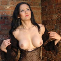 Creamy Asian Skin - Black Hair, Flashing, Large Breasts, Long Hair, Pierced Nipples , Barbel Niple Piercings, Long Thin Fingers, Lovely Collarbones And Neck, Leaning Against Brick Wall, Black Sheer Dress, Large Breasts Coming Out Of Shear Outfit, Red Lipstick, Round Breasts, Flashing Tits, Asian Beauty