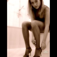 Posing On The Toilet - Heels, Stockings , In The Bathroom, Fine In Fishnets, Looking Into Camera, Fine Art Black And White, Sitting On Toilet Playing With Shoes, Fishnets And Heels, Black Strappy High Heels, Bending Over On Toilet Looking At Camera, Dressing After A Hard Night, Reaching For Shoe Lace, Shot For Shoe Fetishers, Fishnets, Hoop Earrings, Black Fishnet Thigh-hi's, Black And White, Leaning Forward, Sexy Sandals, Black Fishnet Stockings, Black Heels With Strap, Nice Shoes