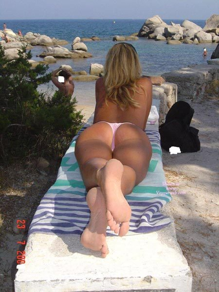 Mature blonde topless at the beach