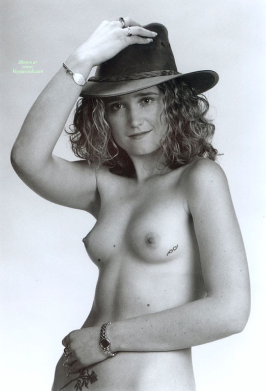 Girl Next Door Nude - Erect Nipples, Topless, Looking At The Camera, Naked Girl, Nude Amateur , Hand On Hat, Topless With Hat, Black And White, Nice Tits, Cowboy Hat, Hand On Head, Glamour Style, Cowgirl, Curly Hair