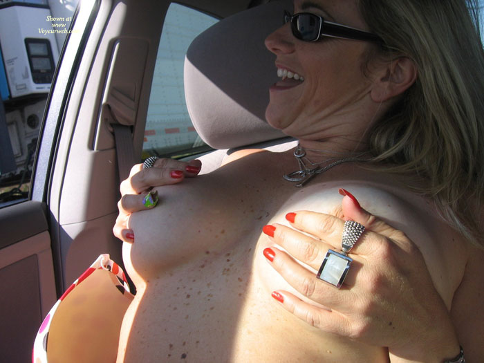 Flashing Truckers - Blonde Hair, Flashing Tits, Flashing, Milf, Topless , Milf In Car, Enjoying The Flash, Sitting In Car With Tits On Hands Pinching Nipples And Looking Out The Window At Passing Trucker, Flashing Topless Blonde Driving In Traffic, Sitting In A Car Flashing, Holding Titties In The Car, Traffic Flashing, Holding Own Breasts, Hiding Tits On Topless Drive, Car Flashing