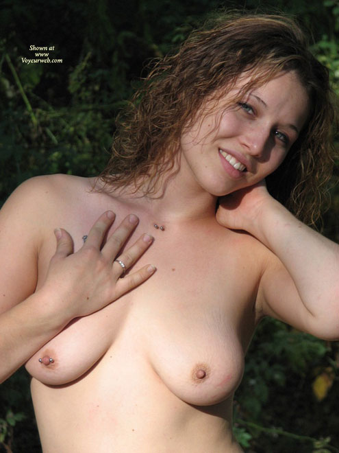 Pierced Nipple On Right Breaast - Brown Hair, Topless, Looking At The Camera, Small Areolas , Girl With Multiple Piercings Poses Topless, Topless Pose With Pierced Nipple, Curly Brown Hair, Cute Face, Short Brown Hair, Pierced Nipple, Hand On Neck, Topless Outdoor