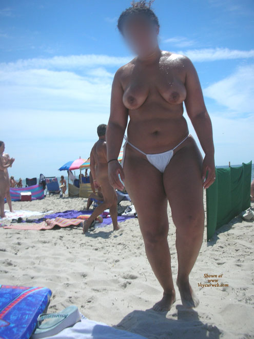 Wet And Oiled @ The Beach , Here's My Lovely Wife Again Taking In Some Waves And Sun At A Local Nude Beach. I Hope You Enjoy.