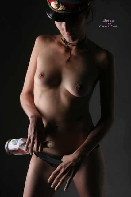 Naked Standing Holding Wine Bottle, Artistic - Erect Nipples, Perky Tits, Small Breasts, Small Tits, Topless , Hiding In The Shadows, Tight Body, Wine And Woman, Artistic On Dark Background With Shadows, Small Breasts And Erected Nipples, Artsy Naked Photo, Topless Wearing Miltary Hat, Thin Arms And Petite Body
