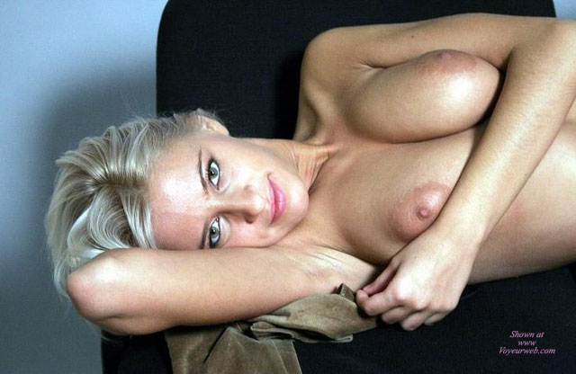 Close Up Topless Blonde Lounging Arm Under Head Arm Across Breast - Blonde Hair, Topless , Nice Eyes, Topless Portrait With Eye Contact, The Eyes Have It, Prone Position, Kissable Lips, Lying Topless On Chair, Beautiful Blond, Playtime, Blond Boobs, Beautiful Eyes