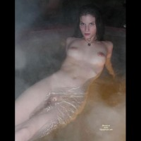 Naked Girl Floating In A Spa - Black Hair, Large Aerolas , Lying Back In Hot Tub, Wet Titties, Hands Behind Back, Naked In Tub, Watching To The Camera, Sculpted Eyebrows, Naked In Water