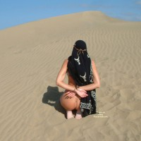 Nude Girl Bound On Dune - Bondage, Naked Girl, Nude Amateur , Kneeling From Behind, Kneeling With Hands In Back, Black And White Pattern Headdress With Leather Strap, Slavegirl Kneeling Naked In Sand, Naked On Sand, Leather Straps Around Wrists, Wrists Tied, Outdoor Ass Shot, Bound Hands, Light Bondage, Black And White Scarf